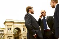 three_businessmen_outside_talking